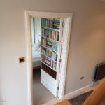 Door open revealing hidden room