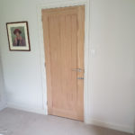 Standard 30 inch - 762mm internal oak door from the inside, clad with faux books on the outer side