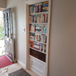 Hidden bookcase door on a standard 30 inch internal door