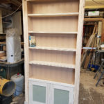 I have made this bookcase ready to fit by the builders as the project was in Surrey. The shelves are adjustable and the doors are on soft close hinges.