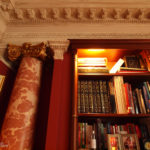 mahogany bookcase with turned fluted columns Fake square column with plaster cornice copied to match the existing