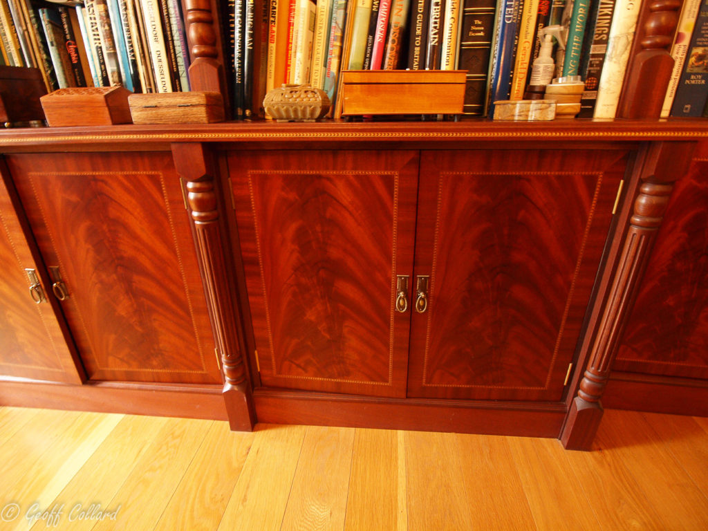 Mahogany curl with inlay and cross banding showing turned fluted columns