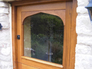Stable door in oak with arched top rail