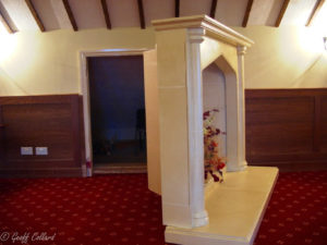 Fireplace open to reveal storage area for function room