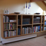 floating bookcase above radiator