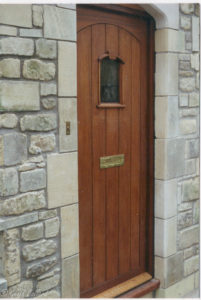 mahogany door with little arch window