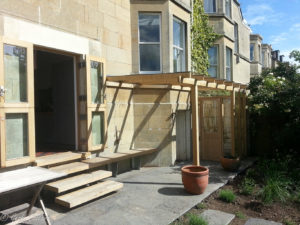 oak lean-to and greenhouse with bench seat