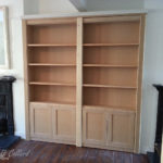 Bookcase in mdf with a secret door leading to a utility room